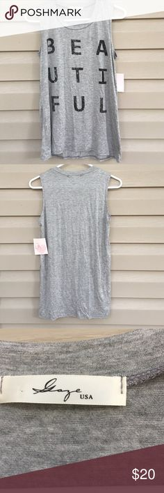 Gaze NWT women's shirt NWT gaze USA sleeveless very soft shirt with beautiful spelled out on front 97% rayon 3% spandex. No stains or holes gaze USA Tops Tank Tops