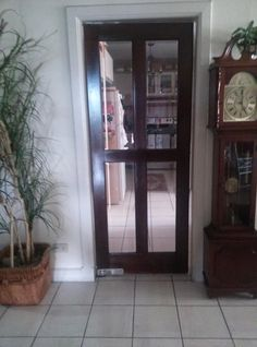 my new kitched swinging door by replacing a wooden door with one with glass panes looks ten times bigger
