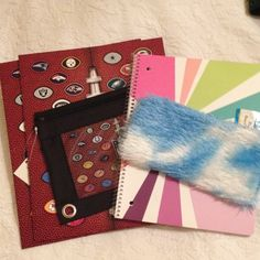 School Bundle Boys and Girls School Bundle . Boys has 2 folders with pockets and a pencil case with holes to go in a binder . NFL Theme . Girls is a spiral notebook with 70 sheets and a fuzzy pencil case . Will add 2 pens and 2 pencils . Great for Stockings !! Accessories