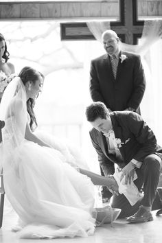 Silver & Lace vintage barn wedding.  photo by The Tarnos.  Groom washing the brides feet.