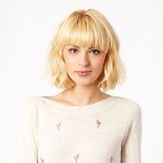 Bob haircut. Blunt, straight bangs and textured body is makes for a classic look with a casual, cute bob.