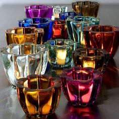 Colorful votive holders are an amazing way to add some interest to a room.  I especially love these ones b/c they're made of recycled glass!