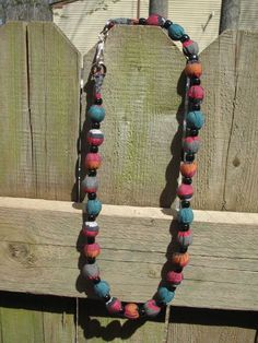 Mandy, they were making these at a festival w/ team sport fabric.  Fabric and Marbles Necklace You could do these!