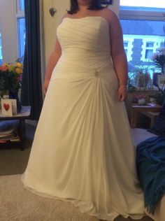 Curvy brides can have strapless plus size wedding dresses like this made exactly to their specific shape. We are custom dress designers who specialize in affordable #custom #weddingdresses for all sizes. This ruched dress can be made with any changes. Our design team can also help a bride on a budget by making a #replica of any haute couture gown for less than the original while still making it look very similar. Find out how when you contact us directly at www.dariuscordell.com/?utm_conte…