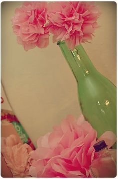 Tissue paper pom poms- I have only thought of these as huge, but they are adorable as small flowers!