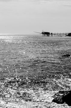 The end of the summer in this shot from the Trabocchi coast, in the city of Fossacesia, region of Abruzzo, Italy. The black and white emphasizes the reflections of the sun on the water in this beautiful day  #Prints available on my website
