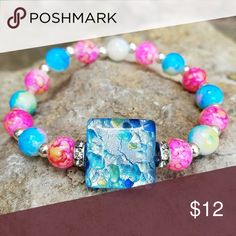 Cracked Glass Beaded Bracelet Cracked Glass Pink, Yellow, and Blue Cuff with silver and rhinestone spacers. Accessories