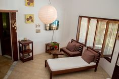 The living room and inside chill-area of Villa Alegre. With SAT-TV and cozy furniture.