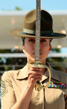 """GunnerySgt. Kristy ShafferOscar Company, 4th Recruit Training BattalionJoined Marine Corps in December 2000 Became a DI: March 2011 Military Occupational Specialty: Supply clerk Hometown: Los Angeles """"I wanted to be a drill instructor because of all the outstanding female Marines that I knew in the operational forces and because of my best friend, Staff Sgt. Carolina Andrade.""""(Photo by Lance Cpl. David Bessey) Staff Sergeant, Military Men, Military Personnel, Women Marines, Female Marines, Female Soldier, Us Marines, Army Women, Once A Marine"""