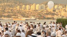 On Thursday night, 1,200 Diner en Blanc attendees, all dressed in white, took over downtown Vancouver for the city's inaugural outdoor pop-up feast. As you might expect, this was the kind of event Vancouverites took to with gusto.    Read more: http://bc.ctvnews.ca/diner-en-blanc-lights-up-vancouver-1.937774#ixzz259DD1WI4