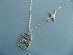 Fly Free Bird Necklace Silver Birdcage Necklace With Flying Sparrow Necklace. $18.50, via Etsy.