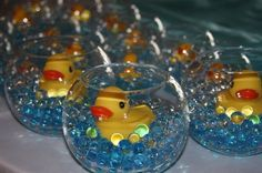 Baby Shower Centerpiece - you can use pink or blue marbles from craft store. Glass bowls from Dollar Tree and a package of rubber ducks. Cute!!