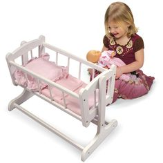 Your little one will love tucking their dolls into this cute Heirloom Style Doll Cradle with Bedding from Badger Basket. This adorable cradle includes a gingham pad, pillow and blanket, and fits dolls up to (sold separately). Baby Doll Accessories, Pink Gingham, Pink White, Baby Bassinet, Wooden Dolls, White Bedding, Doll Furniture, Baby Dolls, Girl Dolls