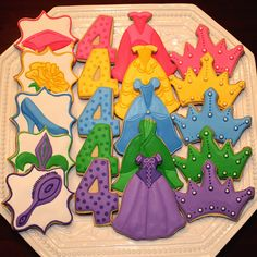 Disney princess inspired birthday cookies.  Dress cookies.  Princess cookies.  Sugar cookies. Decorated cookies.  Belle, Tiana, Cinderella, Sleeping Beauty, Rapunzel.  Birthday Party