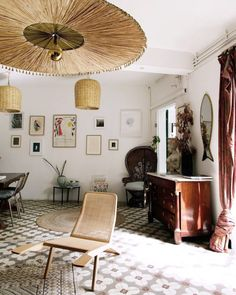 home in marseille, france with patterned floor tiles and eclectic decor via the socialite family blog. #thesocialitefamily #eclectic #eclecticdecor #homedecor #decorating #floortile #flooring #tiledfloors #geometrictile #patternedtile #vintagefurniture #vintagefurnishings #marseille #france #french #interiordesign #interiordecorating