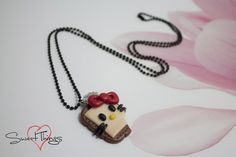 """Hello Kitty's Cookie"" necklace"