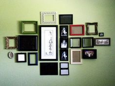 assortment of mis-matched frames on the wall for a whimsical vintage/modern twist