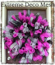 This wreath is so extreme, it doesn't even fit on my door. It makes a grand statement. It's made with a 24 inch deco mesh wreath fram...