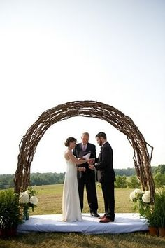I love this beautiful wicker chuppah with florals/greenery on each side. Perfect to include when holding your ceremony on a lake, up in the mountains (Perhaps along side the valley), a vineyard, and a vast open space of meadow land (As similarly shown in the photo).