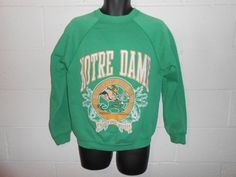 Check out this item in my Etsy shop https://www.etsy.com/listing/222565663/vintage-80s-thin-kelly-green-notre-dame