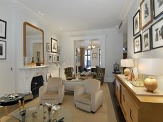narrow living room - 2 sitting areas  Sarah Jessica Parker Selling NYC Townhouse for $25M