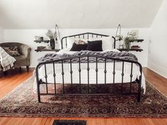 Modern, Vintage Victorian House Tour - Miranda Schroeder Funky Victorian Home Tour White bedroom with black metal bed frame, vintage rug, floating shelf nightstands, and a sitting chair Victorian Bedroom, Bedroom Vintage, Vintage Bed Frame, Vintage Beds, Vintage Bedding, Victorian House, Bedroom Black, Black Bedding, Neutral Bedding