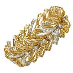 Van Cleef & Arpels Diamond Bow Bracelet. Van Cleef & Arpels 18k yellow gold and palladium diamond lace bow bracelet, accompanied with VCA certificate. c 1940s