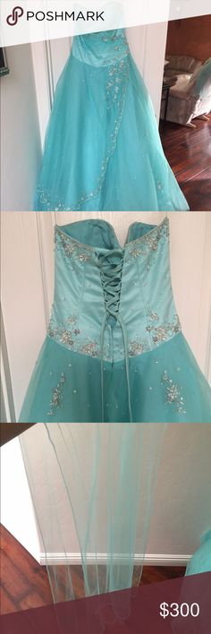 """Quinceañera dress with shawl and crinoline It was only worn once, and has been stored away. The dress is an aqua blue and has a sweetheart neckline. It's strapless, and has many little pearl/crystal details that are sometimes in little flower shapes. The back is a lace up so it could fit girls of different sizes but it is a size 8 dress, and the crinoline is """"one size fits all"""". (I am negotiable on price, but I plan on selling all these items together) Dresses Prom"""