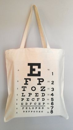 Eye Chart Optometry Tote The Original Eye Chart Tote Bag Gift Available in wooden hoop wall art also Optometry Humor, Optometry Office, Glasses Shop, Eye Glasses, Optic Logo, Eye Chart, Optical Shop, Doctor Gifts, Eye Doctor