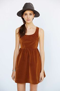 rust velvet a-line dress with gray felt hat