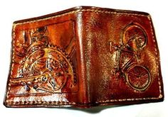 Handmade Leather Cyclist Bicycle Wallet for any Sports Lover. This is a leather wallet with a hand carved image of a bicycle on one side and the pedaling gear on the other. It's a perfect gift for someone who loves cross country biking or trail biking. It started out as a custom order and when my cousin's husband (who loves biking) saw it he got very excited and wanted one for Christmas. This wallet is all about fun. If you are a Bicycling Enthusiast, carrying it with you all day is a…