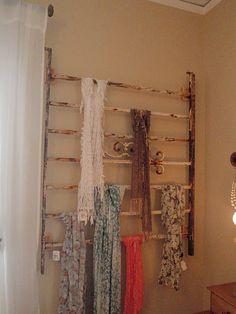 decorative metal railing repurposed as a scarf organizer! Cleaver!