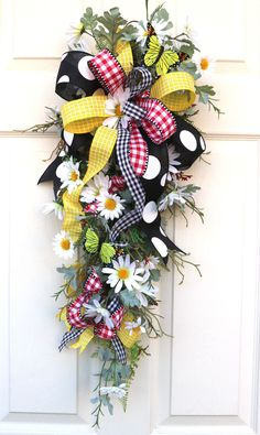 Excited to share this item from my #etsy shop: Daisy Swag, Summer Daisy wreath with Butterflies, Spring Porch Wreath, Summer decor, Wall decor, Sunporch decor, Farmhouse decorations Spring Front Door Wreaths, Spring Wreaths, Mount Laurel, Wired Ribbon, Grapevine Wreath, Gifts For Mom, Bee Decorations, Farmhouse Decor, Christmas Wreaths