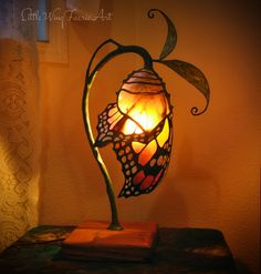 Picking out the best lamp for your home can be hard as there is such a variety of lamps you could choose. Get the most suitable living room lamp bedroom lamp desk lamp or any other style for your particular room. Butterfly Lamp, Flower Lamp, Butterfly Chrysalis, Butterfly Cocoon, Butterfly Fairy, Monarch Butterfly, Butterflies, Lampe Art Deco, Lampe Retro