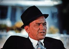 Cock your hat–angles are attitudes. Frank Sinatra  Hats can give you a feeling of effortless cool and manly confidence. Few people loved hats more, or wore them better than Frank Sinatra. He was constantly playing with the idea of angling and tilting his hat to convey different attitudes.