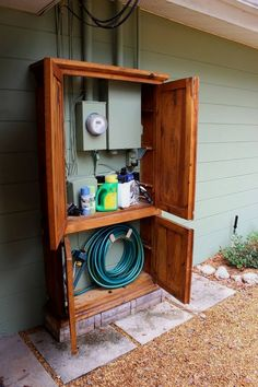 Awesome DIY Outdoor Eyesore Hiding Ideas To Beautify Your Garden Lovely Cabinet Hides Utility Box and Garden Tools Outdoor Projects, Home Projects, Diy Backyard Projects, Backyard Patio Designs, Garden Projects, Sewing Projects, Armoire Makeover, Garage Makeover, Front Porch Makeover