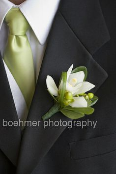 white cymbidium orchid boutonniere for my groom