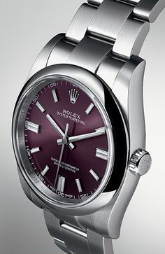 The Rolex Oyster Perpetual 36 in 904L stainless steel, with an enticing red grape dial, a 36mm waterproof Oyster case and an Oyster bracelet.