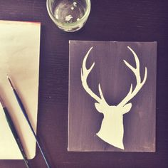 Deer silhouette painting DIY. Takes you step by step on how to paint a deer silhouette on canvas if you have little to no drawing skills. Nest + Foster