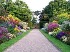 """A beautiful British style garden border. While this is FAR too organized and """"tight"""" for me, I do very much admire it's lines and the very hard work that went into it."""