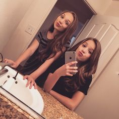 Hey we are Maddie and Mackenzie Ziegler. We are the Grande's cousins! Madz) I'm 14 and single. I'm a professional dancer! Kenz) I'm 13 and single. I'm a professional dancer and a singer. Both) we have an older sister named Amanda. Intro????