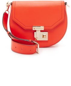 A polished push-lock punctuates the front of this small Rebecca Minkoff saddle bag. Slim back pocket. Top flap and lined, 1-pocket interior. Rebecca Minkoff Paris Saddle Bag
