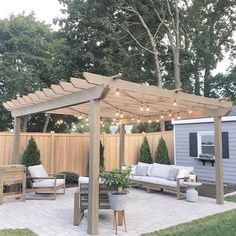 DIY pergola is seriously impressive! Plus, we love how she incorporated matching decor, such as the plant container and side table. Tip: adding twinkle lights to your outdoor space can be the cherry on top! 😍 Share your outdoor space with us using Diy Pergola, Pergola Shade, Diy Patio, Pergola Kits, Pergola Roof, Curved Pergola, Outdoor Pergola, Cheap Pergola, Pergola Screens