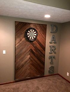 Wooden dart board wall in the man cave or game room. Basement Makeover, Basement Renovations, Home Remodeling, Basement Remodel Diy, Game Room Basement, Basement House, Basement Ideas, Gameroom Ideas, Basement Bathroom