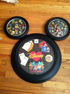 Three clocks that I bought at the dollar store, a package of 12x12 corks that I cut to fit inside and memorabilia from our Disney trip. Turned out nice and fits right in with our Disney room!