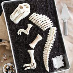 Jurassic cake! Excavate candy dinosaur bones on this triple chocolate sheet cake.