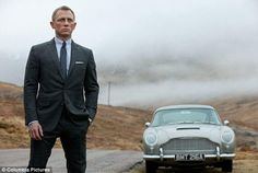 'Skyfall' - suited Dan poses with DB5 in Scotland.