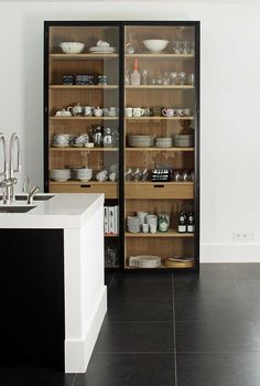 Two colour wood glass kitchen cabinets. LOVE