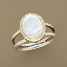 CAMEO PEARL RING--Cultured freshwater pearl presents a lustrous countenance set in a high sterling silver bezel rimmed in 14kt gold. A handmade exclusive in whole sizes 5 to 10.