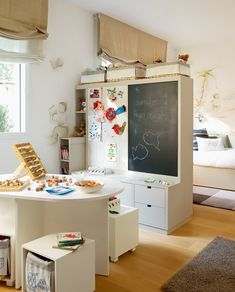 chalkboard cabinet separates play- study area from the bed..